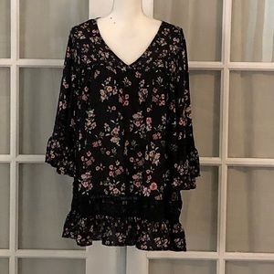Black floral print blouse with lace and ruffles.